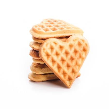 Stack of heart shaped waffles isolated on white background photo