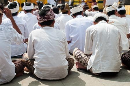 Boys praying in hindu temple Pura Tirta Empul, Bali, Indonesia