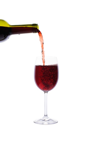 Red wine pouring into wine glass isolated on white background Stock Photo - 17430473