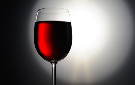 Closeup of red wine wineglass on dark background Stock Photo - 17430567