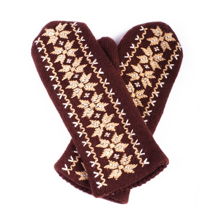 Brown woolen knitted mittens on white background Stock Photo - 17429281
