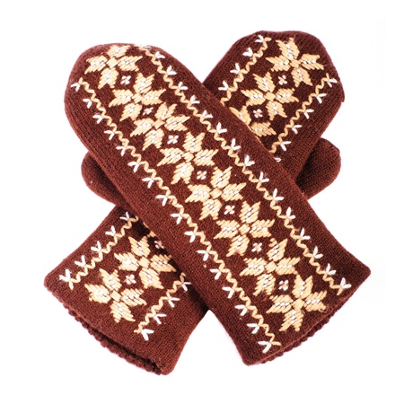 Brown woolen knitted mittens on white background