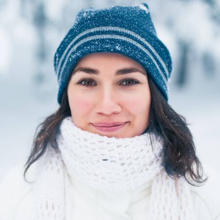 Portrait of beautiful young girl in winter day photo