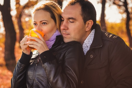 Young family drinking coffee in autumn forest Stock Photo - 17429569