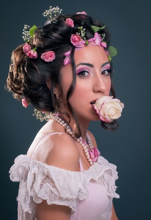 Young girl with creative hairstyle with flowers