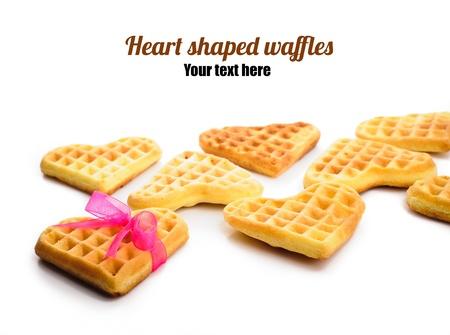 Heart shaped waffles isolated on white background photo