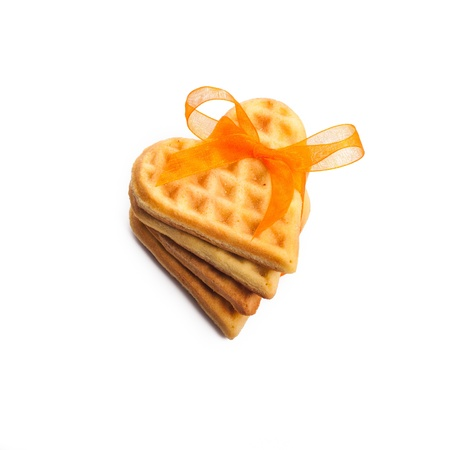 Stack of heart shaped waffles isolated on white background photo