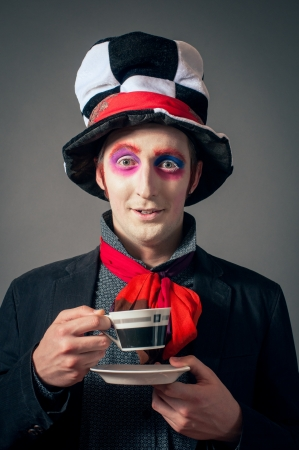 Young man in the image of the Crazy Hatter photo