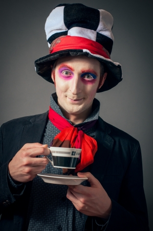 Young man in the image of the Crazy Hatter from Alices Adventures in Wonderland by Lewis Carroll Editorial