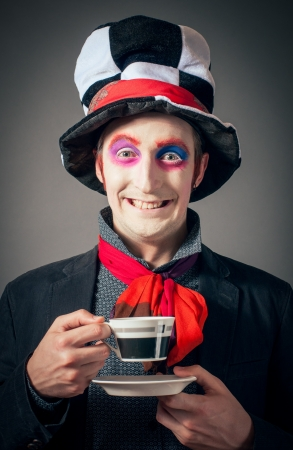 Young man in the image of the Crazy Hatter from Alices Adventures in Wonderland by Lewis Carroll