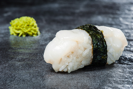 Sushi with scallop and nori on gray stone Stock Photo