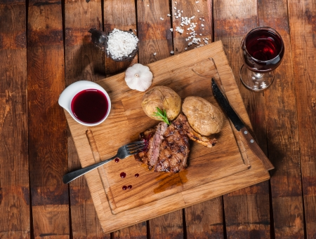 bbq sauce: Steak with spices, thyme and chili served on a cutting board Stock Photo