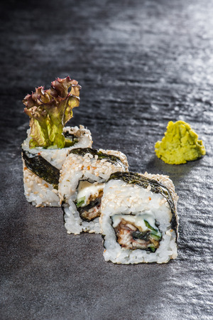 Unagi Onigara - traditional sushi with tempura ell, cucumber and cheese photo