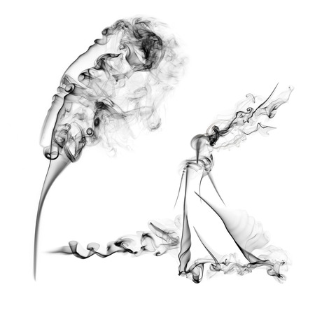 Womans figure made from black smoke isolated on white background photo