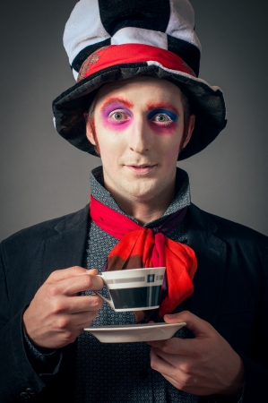 Young man in the image of the Crazy Hatter from 'Alice's Adventures in Wonderland' by Lewis Carroll