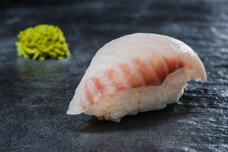 Sushi with perch and rice on gray stone