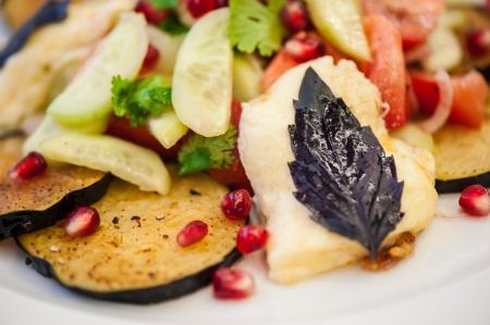 Georgian salad with eggplants, tomatoes, onion, cucumbers, garnet and cheese