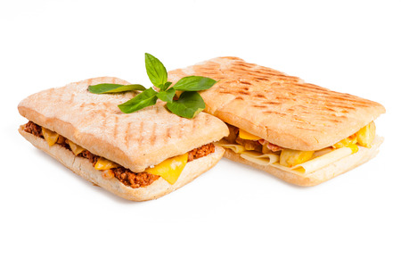 Panini with meat and cheese isolated on white background photo