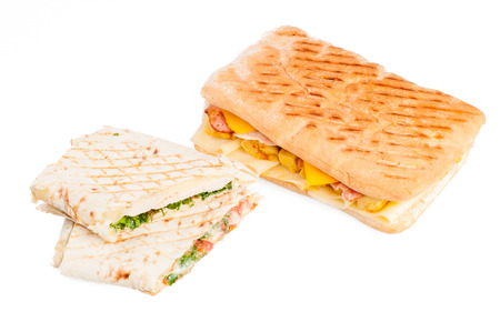Pita sandwich with cheese and panini with meat isolated on white background photo