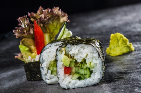 Vegetable roll - traditional sushi with pepper, avocado and cucumber