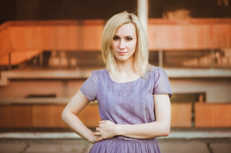skeptic: Young girl in purple dress with skeptic smile Stock Photo