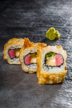 Hot tempura roll with tuna and green onion Stock Photo