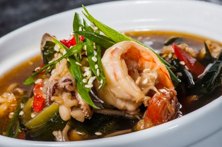 Traditional japanese soup with seafood, seaweeds and prawns photo