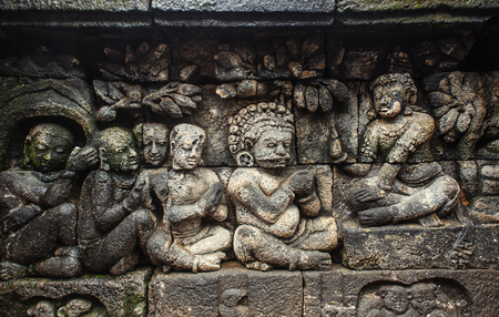 MAGELANG, INDONESIA - DECEMBER 20: bas-relief in ancient buddhist temple Borobudur on 20 december, 2013 in Magelang. Borobudur is the biggest and most visited buddist temple in Indonesia photo