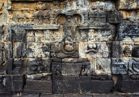 bas-relief in ancient buddhist temple Borobudur on 20 december, 2013 in Magelang. Borobudur is the biggest and most visited buddist temple in Indonesia photo