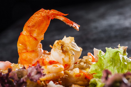 prepared food: Hibachi rice with seafoods, prawns and lettuce