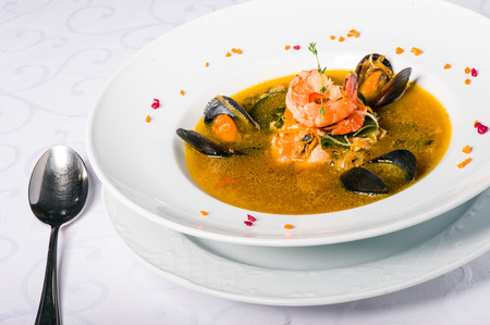 walleye: Soup with mussels, tiger shrimp, walleye, squid, salmon and vegetables