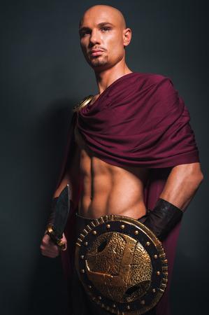 Studio portrait of man in spartan costume Stock Photo