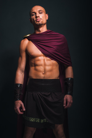 Studio portrait of man in spartan costume Stock Photo