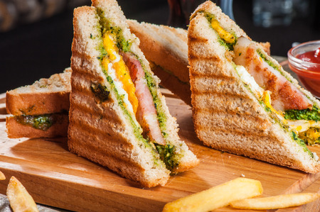 toast bread: Grilled sandwiches with chicken and egg served with french fries