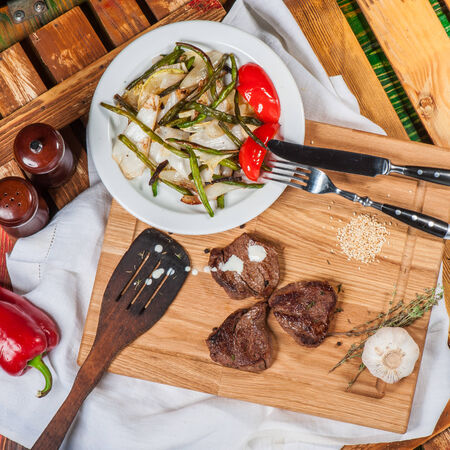 pepper castor: Fried spicy meat served with grilled pepper and asparagus Stock Photo
