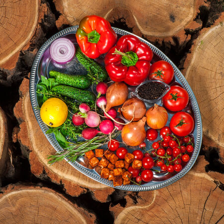 Different kinds of vegetables on silver dish photo