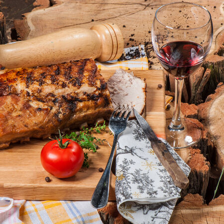 Grilled lamb on wooden board with red wine Stock Photo