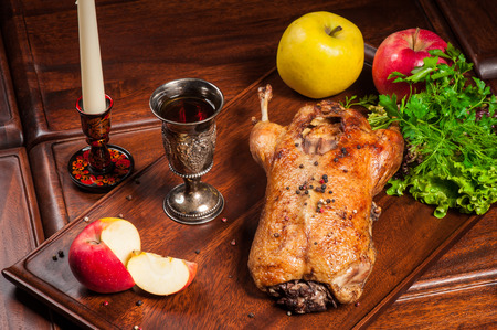 Fried duck stuffed with apples with fresh dill and parsley