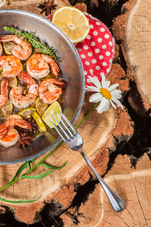Big shrimps fried with lime, lemon and other spices Stock Photo