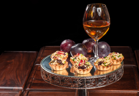 Tartlets with chicken, olives, cheese and other ingredients