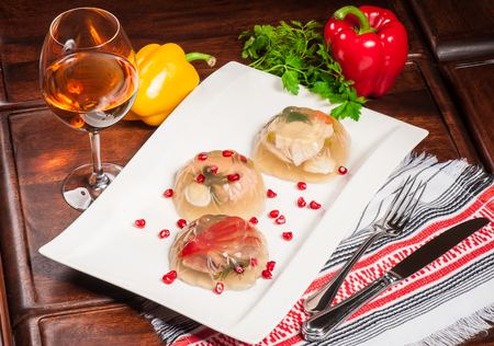 Traditional russian aspic served with fresh parsley and white wine