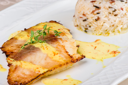 Grilled halibut with cream sauce and rice
