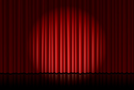 Spotlight on red curtain