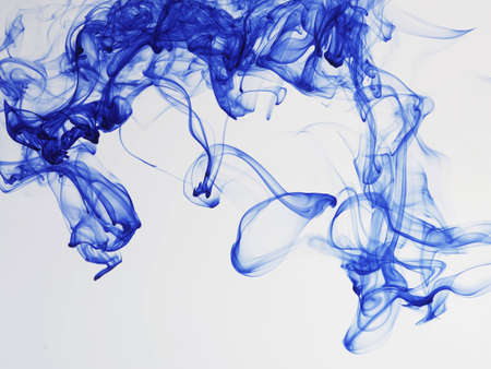 flaw: Blue ink underwater. Stock Photo
