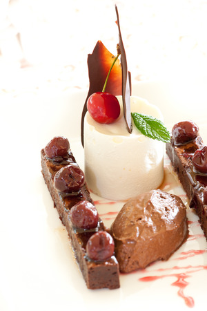 A modern combination of chocolate, kirsch creme and cherries photo