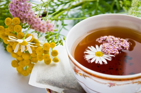 curative: Curative tea with daisywheel and herb Stock Photo