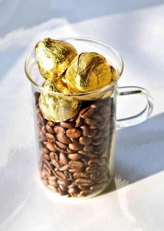 sweetmeats: coffee and sweetmeats in gold(en) foil Stock Photo