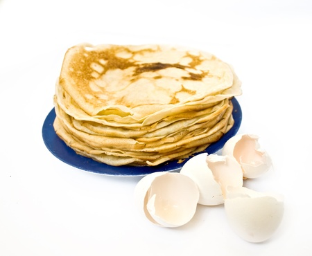 pancake and shell in white photo