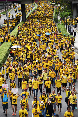 electoral system: Kuala Lumpur, Malaysia November 19, 2016 Rally goers march on during the Bersih 5 rally to call for a new and cleaner electoral system in Malaysia.