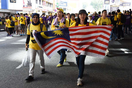 electoral system: Kuala Lumpur, Malaysia  November 19, 2016 Rally goers hold a Malaysian flag during the Bersih 5 rally to call for a new and cleaner electoral system in Malaysia. Editorial